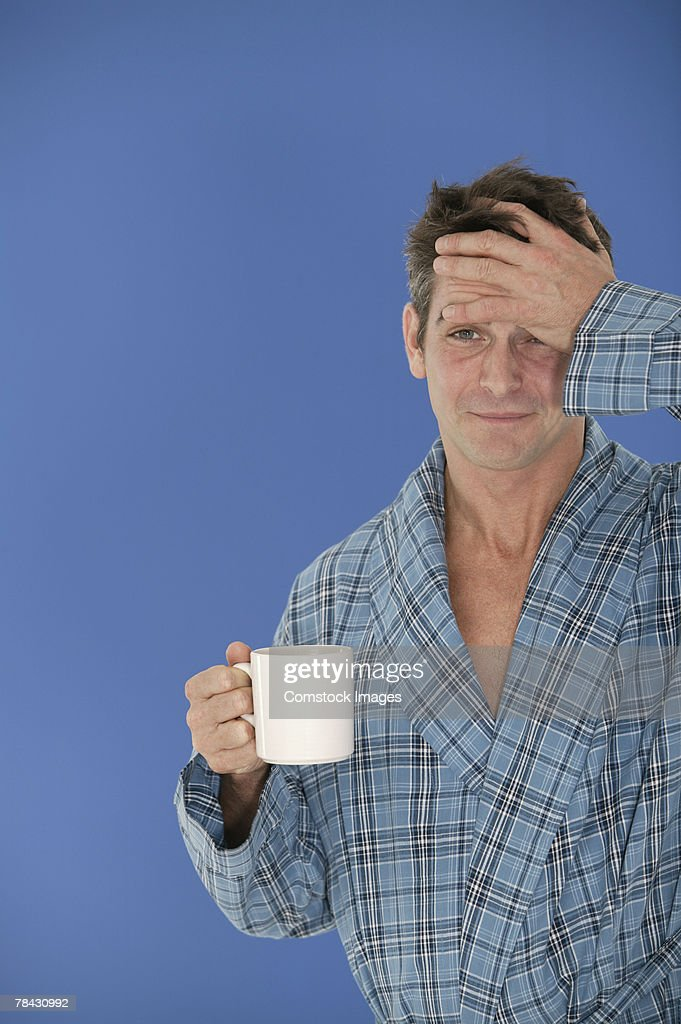 Man holding mug of coffee : Stock Photo
