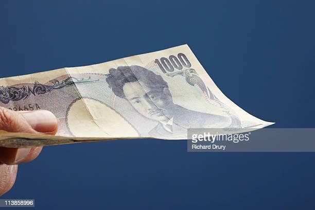 Man holding one thousand Yen note
