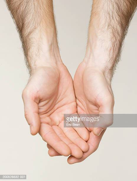 Man holding out cupped hands, close-up