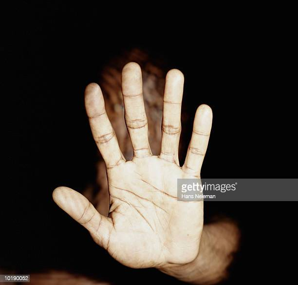 Man holding out palm of hand, close-up