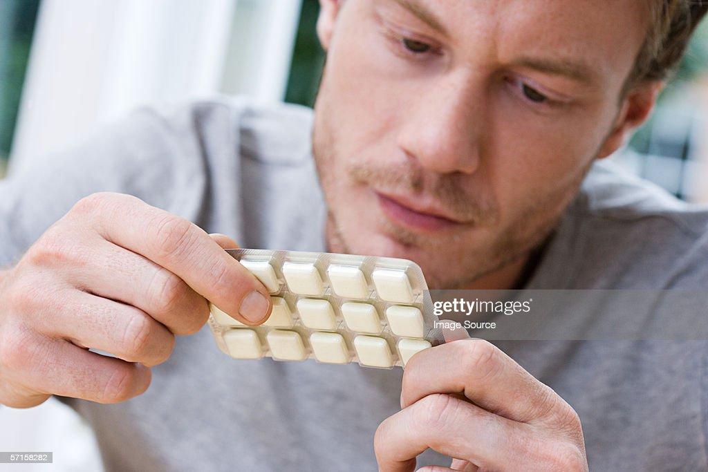 Man holding packet of nicotine gum : Stock Photo