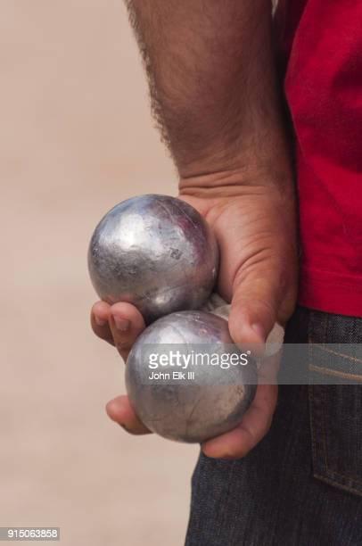 Man holding petanque balls