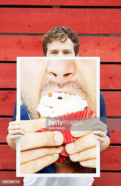 man holding picture of cake
