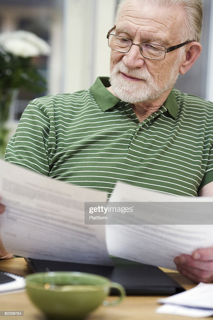 A man holding pieces of paper Sweden. : Stock Photo