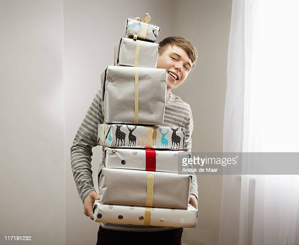 Man holding pile of christmas presents