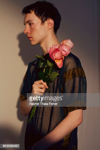Man holding pink roses in studio