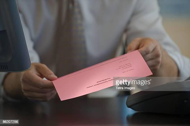 Man holding pink slip