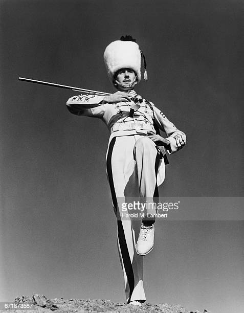 man holding pole and marching - {{relatedsearchurl(carousel.phrase)}} ストックフォトと画像