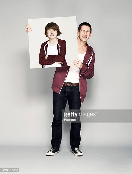 Man holding portrait of himself as a child