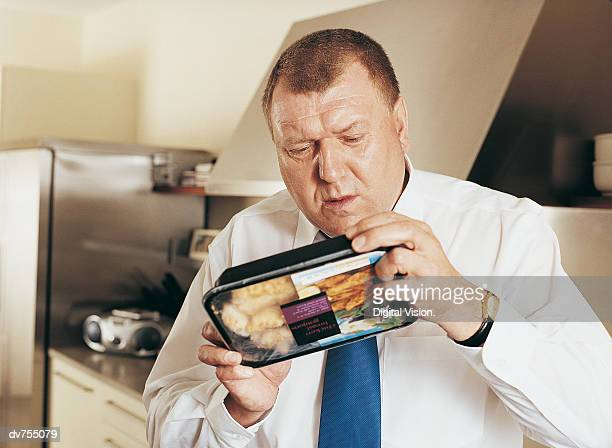 Man Holding Reading Label on Food