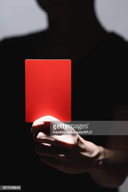 Man holding red card