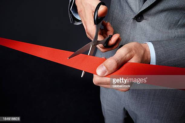 Man holding ribbon