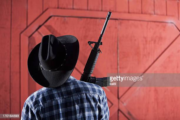 man holding rifle - gun control stock pictures, royalty-free photos & images