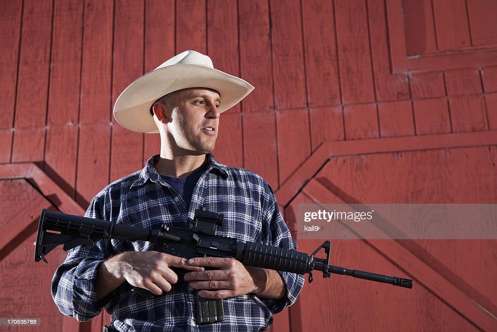 Man holding rifle : Stock Photo