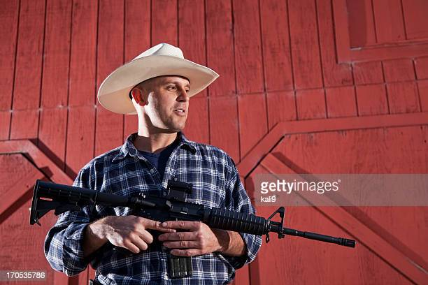 man holding rifle - ar 15 stock pictures, royalty-free photos & images