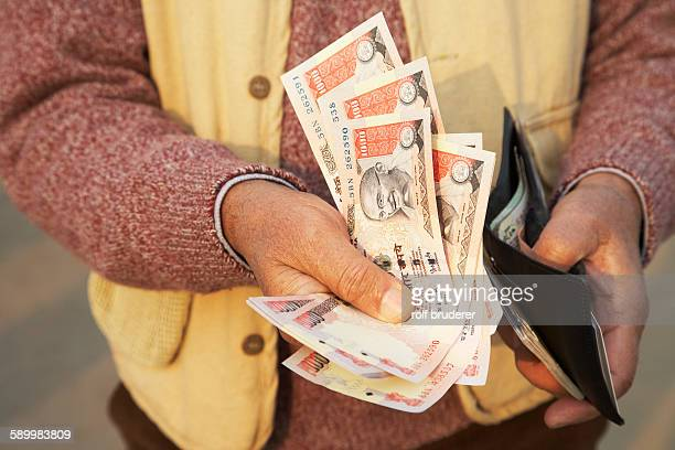 Man Holding Rupees