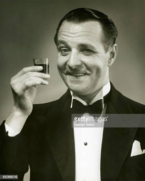 Man holding shot of alcohol
