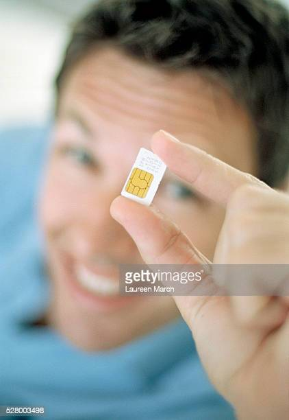Man Holding SIM Card for Mobile Phone