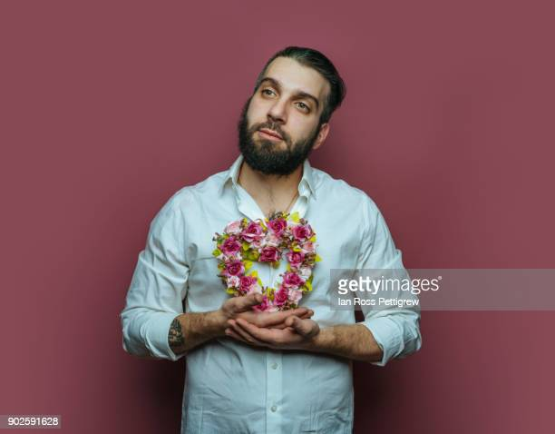 Man holding small heart wreath