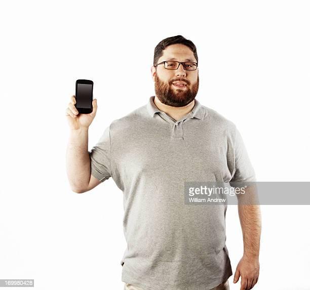 man holding smart phone towards viewer - fat man beard stock photos and pictures