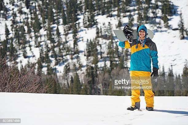 Man holding snowboard
