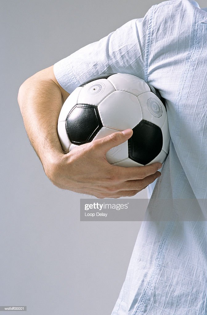 Man holding soccer ball : Stock Photo