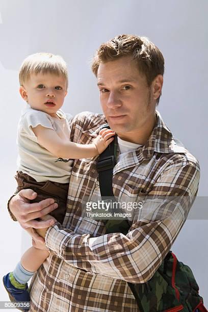 Man holding son