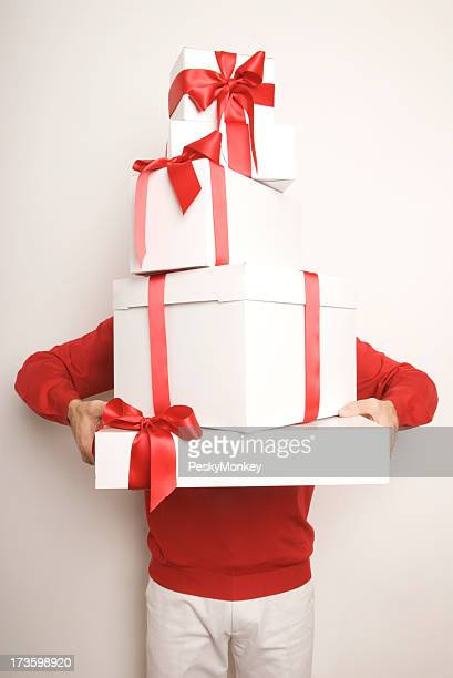 Man Holding Stack of Christmas Holiday Presents with Red Bows