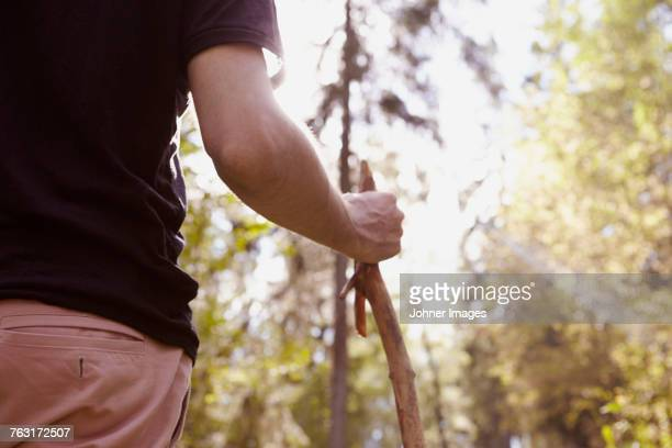 Man holding stick