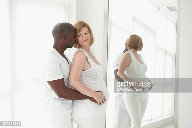 Man holding stomach of pregnant girlfriend