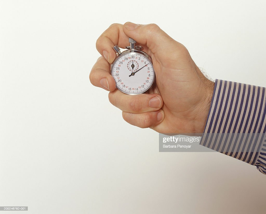 Man holding stopwatch, Close-up of hand : Stock Photo