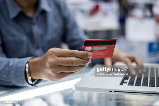man holding tablet pc and credit card indoor, shopping online - home shopping stock pictures, royalty-free photos & images