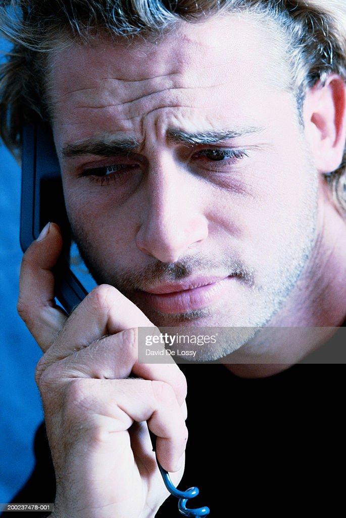 Man holding telephone receiver : Stock Photo