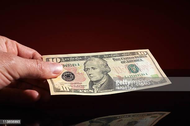 man holding ten dollar note - richard drury stock pictures, royalty-free photos & images