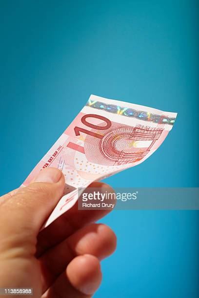 Man holding ten Euro note