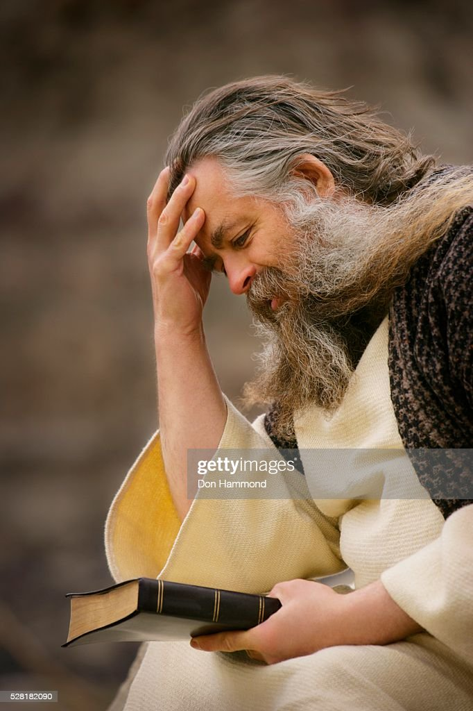 Man Holding the Bible and Thinking : Stock Photo