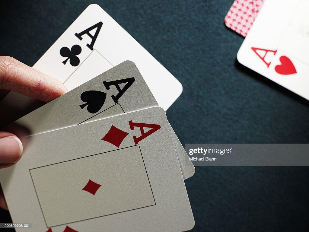 Man holding three aces, close-up : Stock Photo