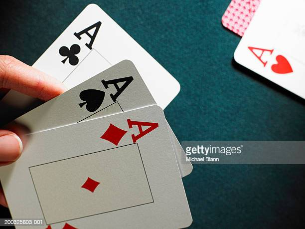 man holding three aces, close-up - hand of cards stock photos and pictures