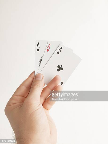 Man Holding Three Aces