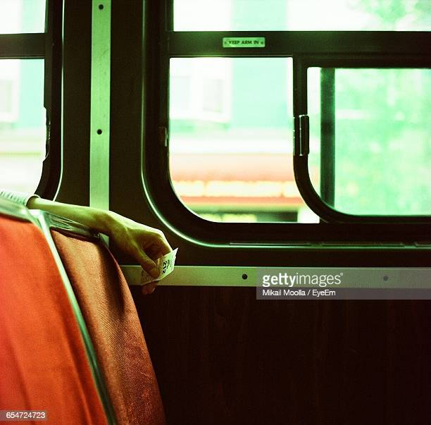 Man Holding Ticket In Bus
