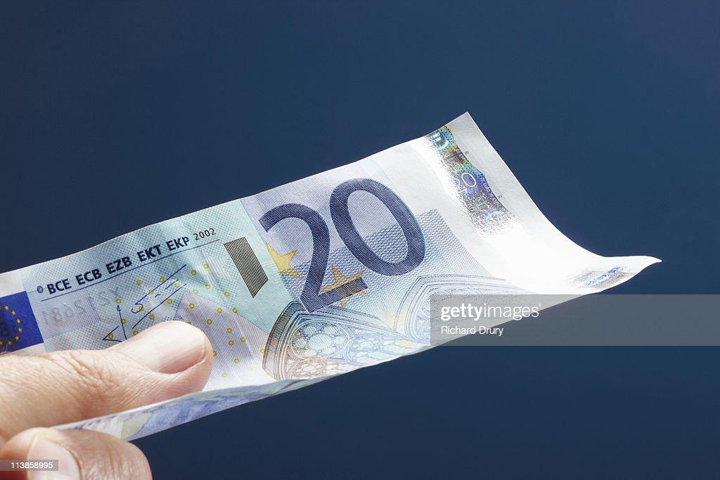 Man holding twenty Euro note : Stock Photo