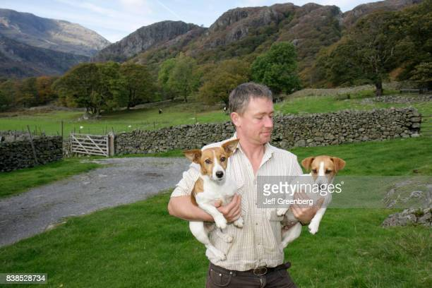 A man holding two Jack Russell terriers on Yew Tree Farm