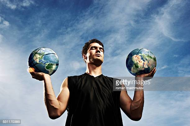 Man holding two planets