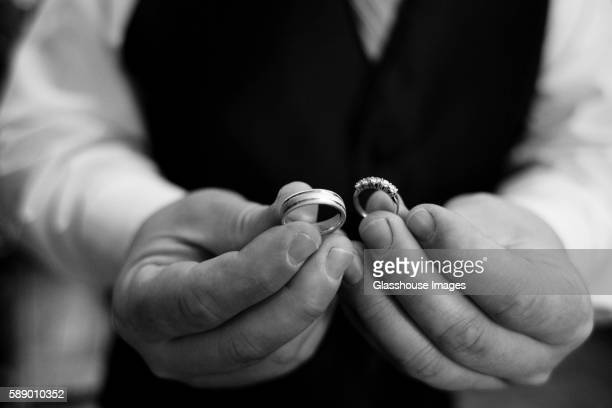 Man Holding Two Wedding Rings