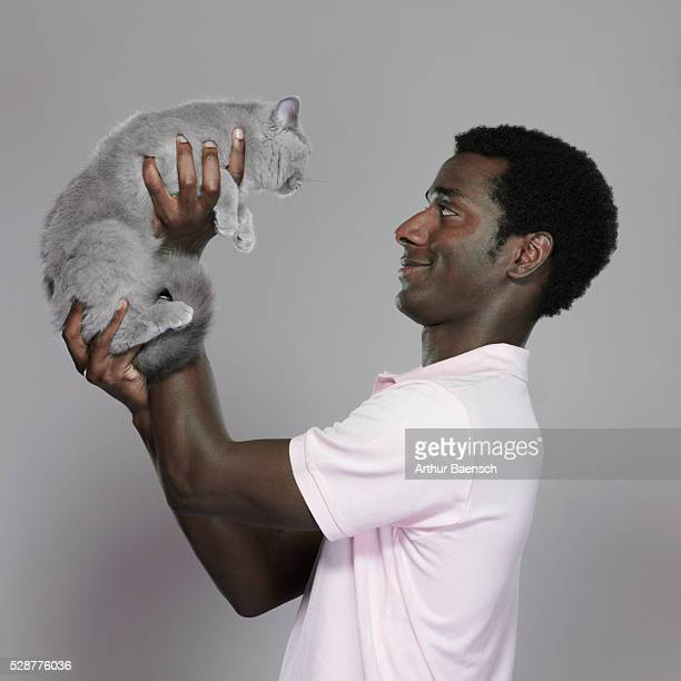 Man holding up his cat