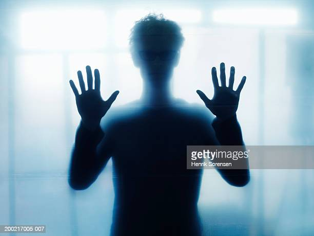Man holding up palms (defocussed)