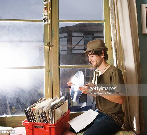 man holding vinyl record.