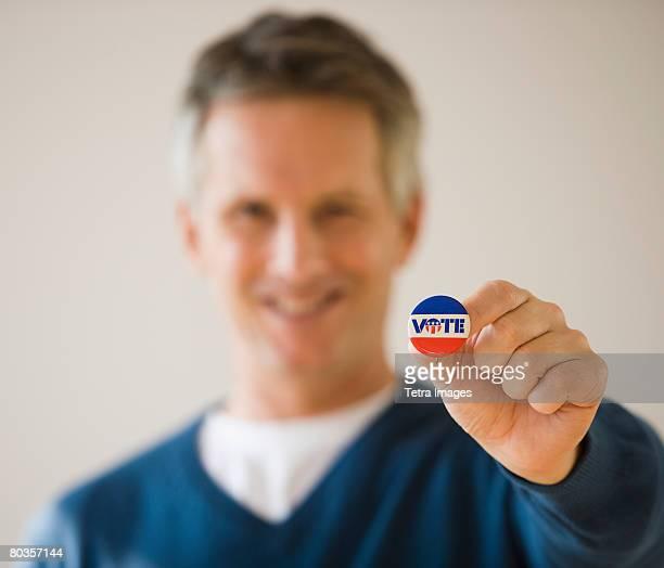 Man holding Vote button