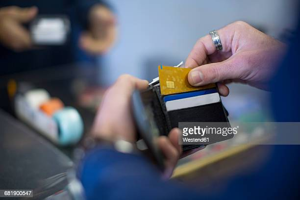 Man holding wallet with cards