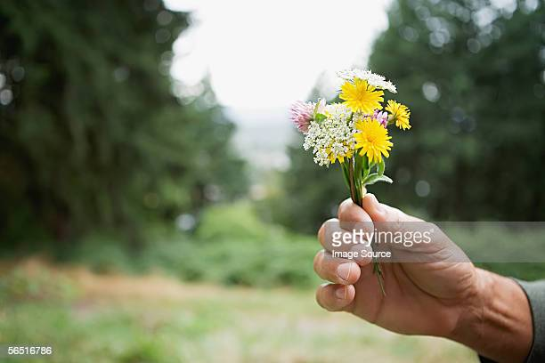 Man holding wildflowers